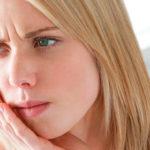 Болит зуб под пломбой – в чем причина и что делать?