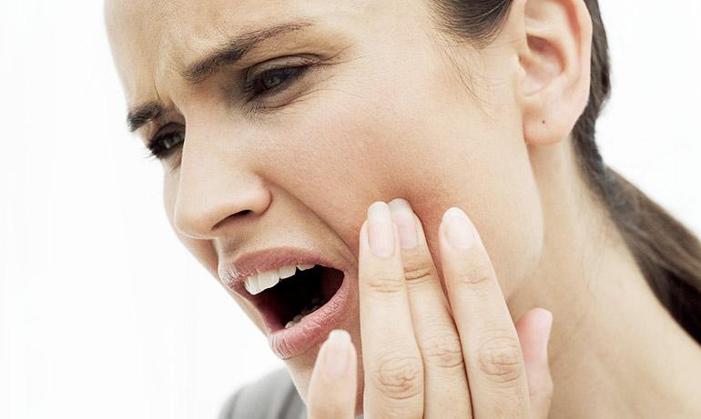 Воспаление корня зуба под коронкой